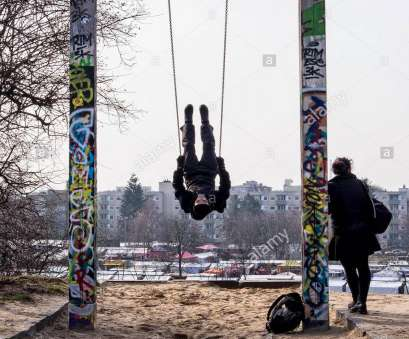 Swing In Berlin Young, using swing with young woman waiting at Mauerpark, Berlin, Mauer Public Park, Wall Park Swing In Berlin Exklusiv Young, Using Swing With Young Woman Waiting At Mauerpark, Berlin, Mauer Public Park, Wall Park